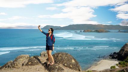 Female tourist taking photos on Merese hill