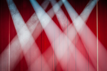 Defocused background concert, blurred stage with lights. Close up. Red background.