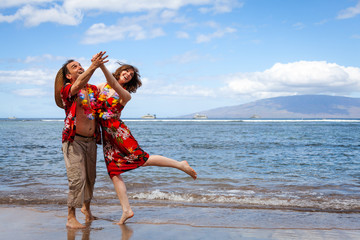 Happy Couple on Vacation in Hawaii Dancing on the Beach