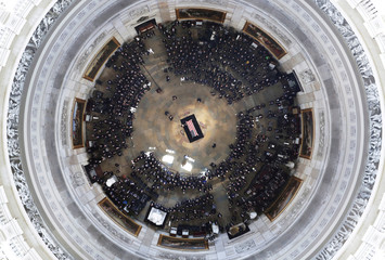 Cindy McCain, wife of the late U.S. Sen. John McCain, R-Ariz., stands over his casket as he lies in state in the U.S. Capitol Rotunda