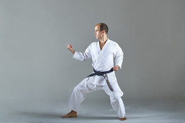 Adult sportsman is training formal karate exercises