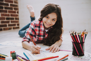 Cute Girl Drawing Pictures with Color Pencils
