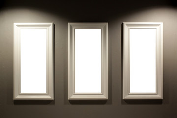empty picture frames on the wall with lighting