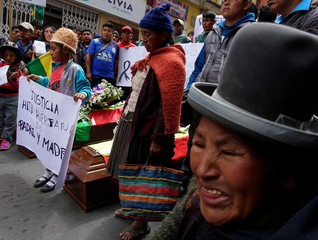 Relatives of coca growers who died during clashes with police forces, who have the task of eradicating illegal coca plants, march in La Paz