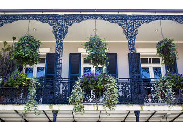 Black and White Balcony with Spring Flower Baskets Overlooking the French Quarter in New Orleans, Louisiana, USA Fotomurales
