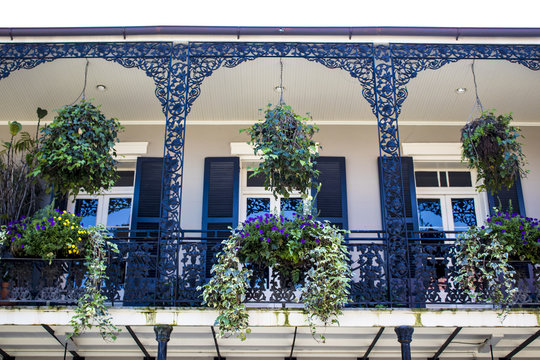 Black and White Balcony with Spring Flower Baskets Overlooking the French Quarter in New Orleans, Louisiana, USA