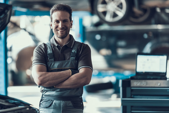 Handsome Smiling Car Machanic Standing in Garage