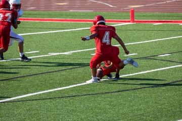 Football player kicking a field goal
