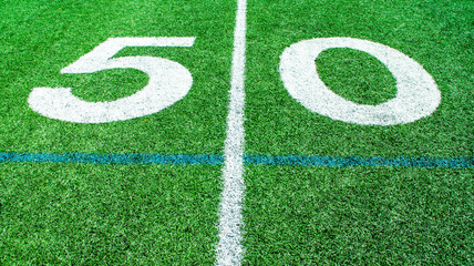 numbers marking the 50 yard line on an American football field