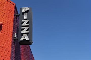 Broken neon Pizza sign