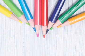 multicolored slips of pencils, close-up, on a light background, lie on top