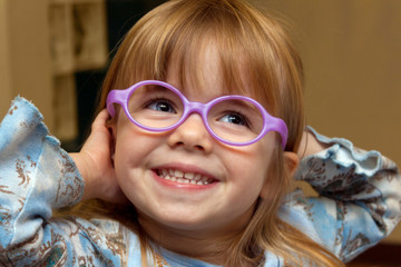 Young Girl with Strabismus Tries on New Glasses Frames On