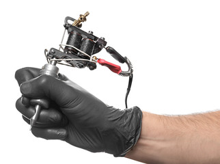 Professional tattoo artist with machine on white background