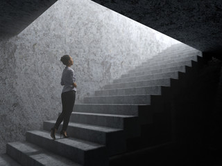 woman climbs the stairs from darkness to light Fototapete