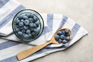 Flat lay composition with juicy blueberries on color table