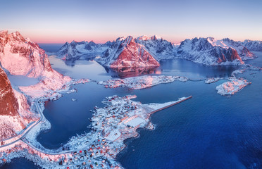Aerial view at the Lofoten islands, Norway. Mountains and sea during sunset. Natural landscape from air at the drone. Norway at the winter time