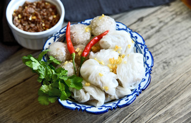 Steamed rice-skin dumplings and Tapioca Balls with Pork Filling with chili and coriander (Thai name is saku-sai-moo and Kow Griep Pag Mor)