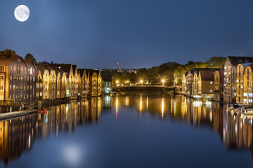 Trondheim and Nidelva River at 2 am in the night with full moon, Norway.