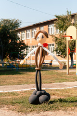 Balloon man dolly in the summer sun on school garden