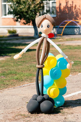Balloon man dolly in the summer sun on school garden