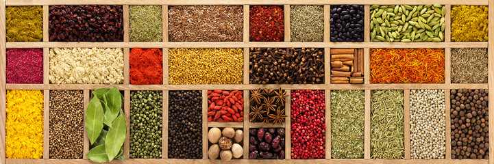 Fototapete - spices and herbs for cooking different dishes. seasoning in wooden box, background, top view.