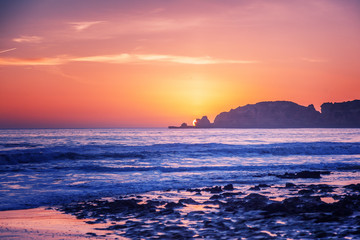 Fototapete - beautiful stunning magical ocean landscape, coast of Portugal, the Algarve at sunset,