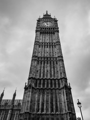 Big Ben clock tower against cloudy sky near Westminster Palace and Houses of Parliament in London England has become a symbol of England and Brexit discussions. Black and white.