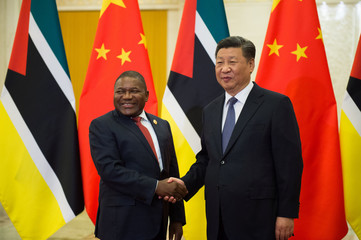 Mozambique's President Filipe Nyusi shakes hands with China's President Xi Jinping before their bilateral meeting at the Great Hall of the People in Beijing