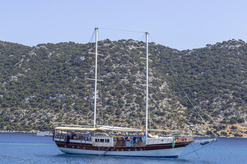 Wide shoot of wooden travel yacht sails on the Mediterranean sea