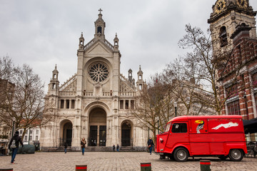 St. Catherine's Church and the vintage red food truck in a freezing winter day
