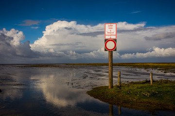 danger sign at the beach from husum, north sea