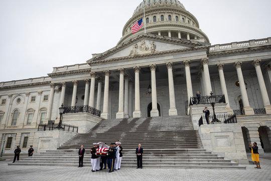 Senator John McCain leave US Capitol