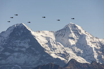 The Swiss Air Force flies with its helicopters a display between the Eiger north face and the Jungfraujoch in the Alps in the Bernese Oberland in Switzerland