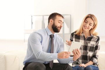 Consulting manager with woman at meeting in office