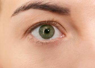 Eye of beautiful young woman before applying eyelash extensions, closeup