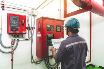 Engineer checking industrial generator fire control system