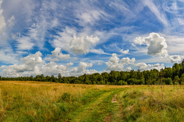 Landscape with clouds in the summer sky. The last days of August.
