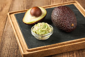 Fresh avocado on wooden table