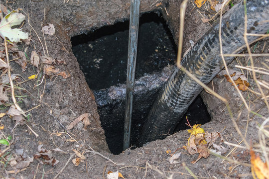 Pumping out of septic tank