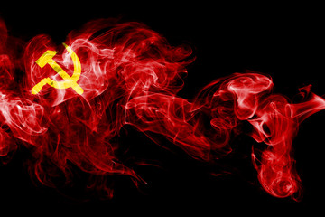 National flag of USSR made from colored smoke isolated on black background. Abstract silky wave background.