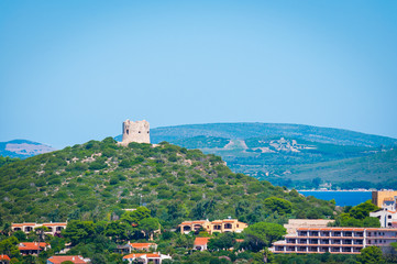 Landscape of sardinian coast with ancient tower