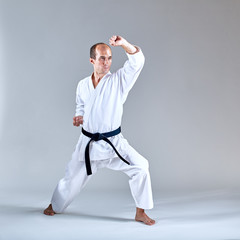 Block the hand athlete trains in a formal exercise karate