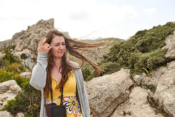 young woman portrait with Formentor Landscape, Mallorca, Balearic island, Spain