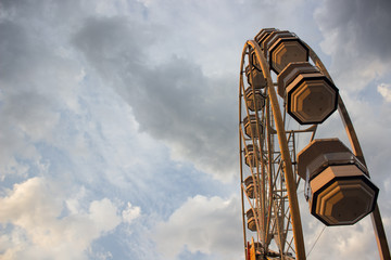 ferris wheel construction object on gray rainy sky backgroud with empty space for copy or text