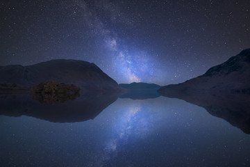 Printed kitchen splashbacks Night blue Vibrant Milky Way composite image over landscape of Crummock Water in Lake District England
