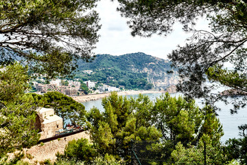 Beach at Tossa de Mar and fortress in a beautiful summer day, Costa Brava, Catalonia, Spain