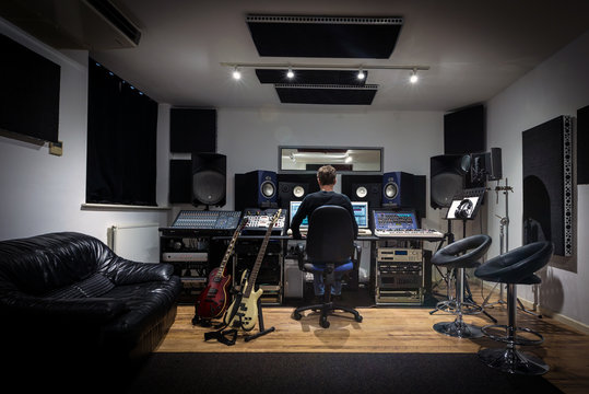 Modern Recoding Studio Control Room with Engineer Mixing