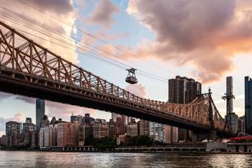 New York City / USA - JUL 27 2018: Midtown Manhattan view from Roosevelt Island at sunset