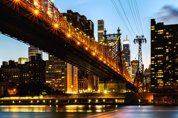 New York City / USA - JUL 27 2018: Queensboro Bridge view from Roosevelt Island at sunset