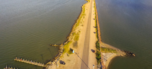 Panorama aerial view famous Texas City Dike with wooden piers, a levee that project nearly 5miles south-east into mouth of Galveston Bay. Designed to reduce impact of sediment accumulation along bay